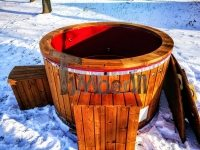 Electricity heated outdoor whirlpool hot tub with thermo wood dressing