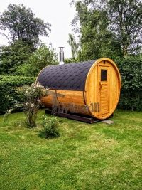 Outdoor barrel sauna in garden Germany