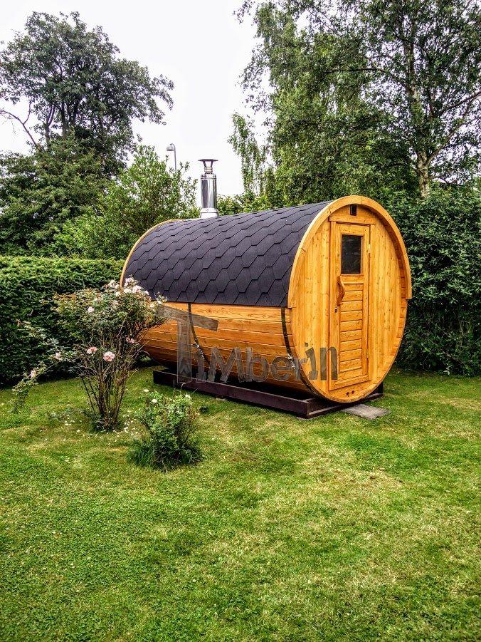 Outdoor barrel sauna in garden Germany
