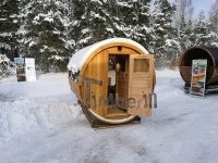 Outdoor barrel sauna with full panoramic window in winter (1)