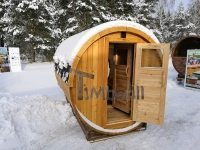 Outdoor barrel sauna with full panoramic window in winter (2)