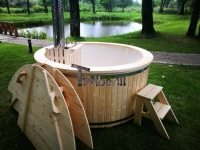 Outdoor whirlpool hot tub with snorkel wood fired heater