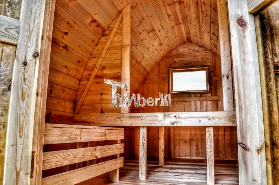Camping glamping pods inside with wooden benches and bed