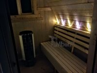 DIY outdoor sauna project completed - right side benches with LED light visible