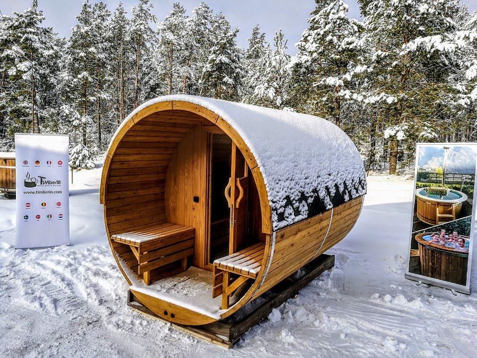outdoor barrel garden sauna with a porch